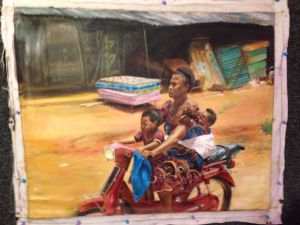 Igbo woman on bike